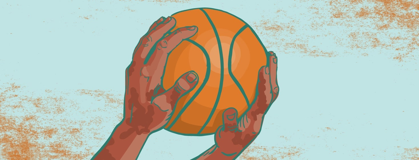 hands with an eczema flare up holding a basketball