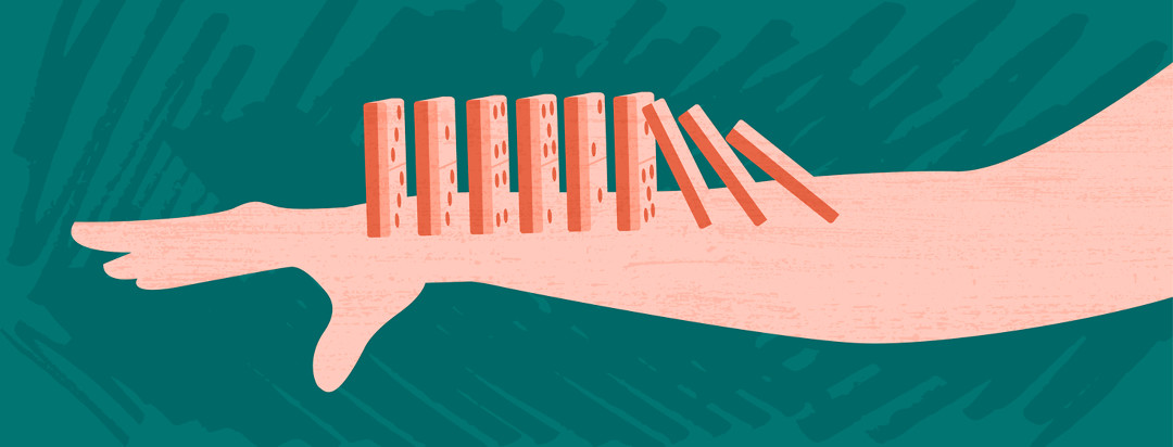 A hand and forearm is outstretched with dominoes springing up from the skin, toppling over, creating a domino effect of skin conditions that occur as a result of AD.