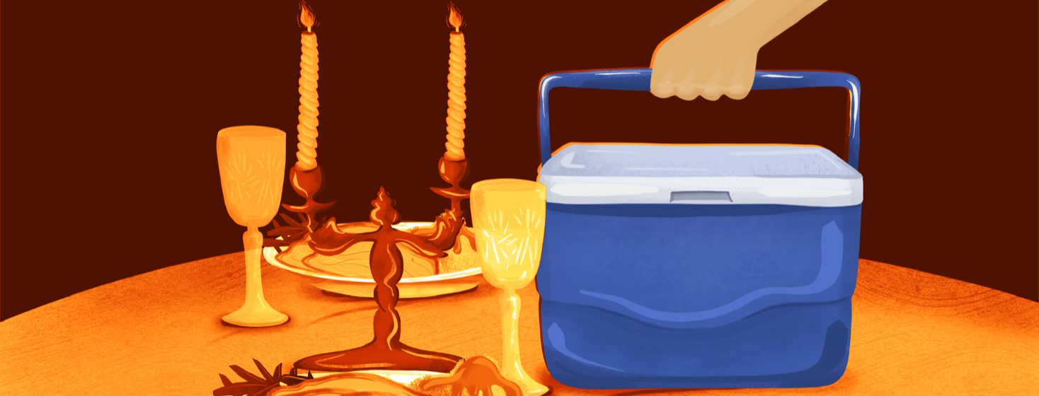 A candlelit table is set for Thanksgiving, while a large cooler is plopped down in the center.