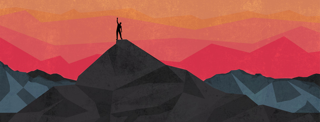 Person stands victoriously on top of a mountain.