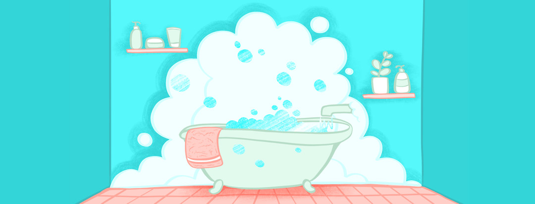 A steamy bubble bath overflowing in a clean bathroom