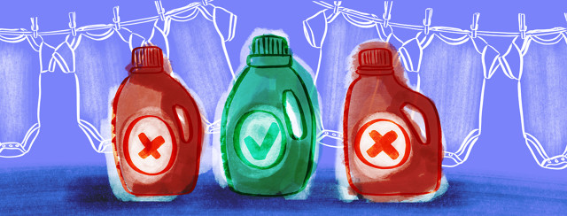 Three bottles of laundry detergent are sitting in front of onesies being hung to dry in the background. Two bottles are red with x's on them, the middle bottle in green with a check mark.