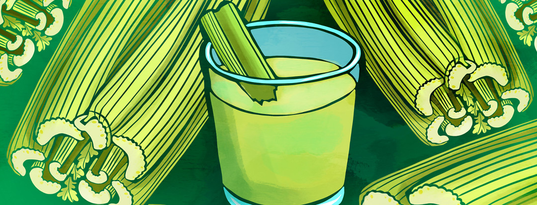 A glass of celery juice in the middle of bunches of raw celery stalks.
