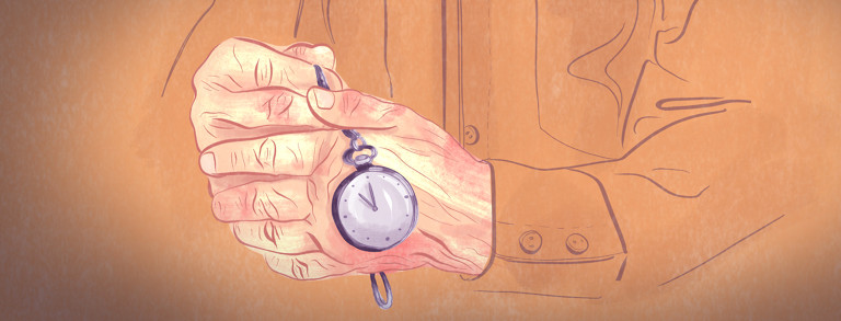 Aged hands hold a small pocket watch.