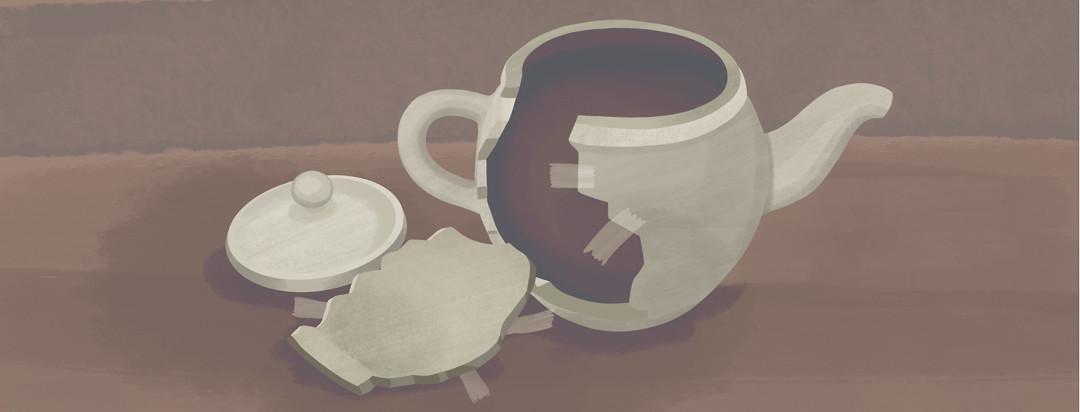 Broken teapot held together by tape