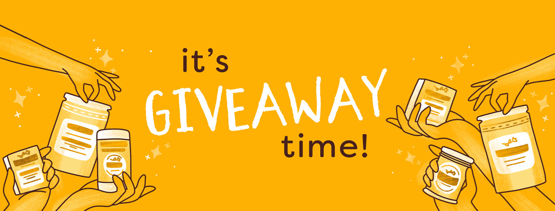 """Multiple hands holding different Satya Organic products are shown with the text reading """"It's Giveaway Time!"""""""
