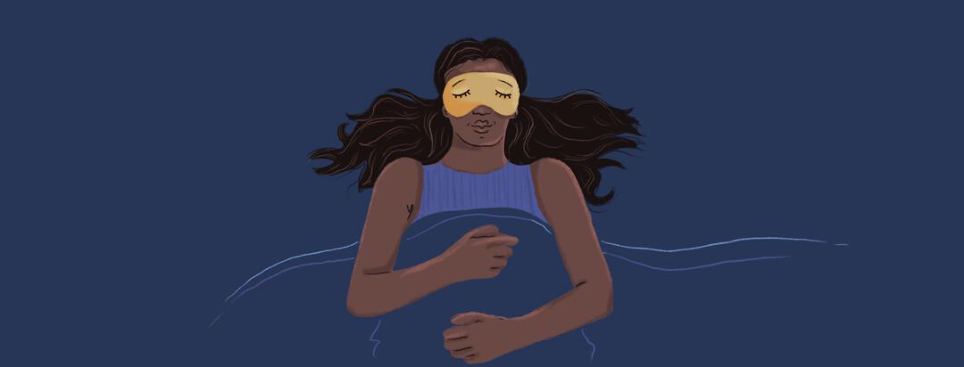 A woman sleeps peacefully and soundly with a sleep mask on.