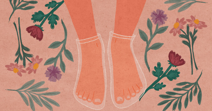 A pair of feet with clear masks on them, surrounded by botanical elements.
