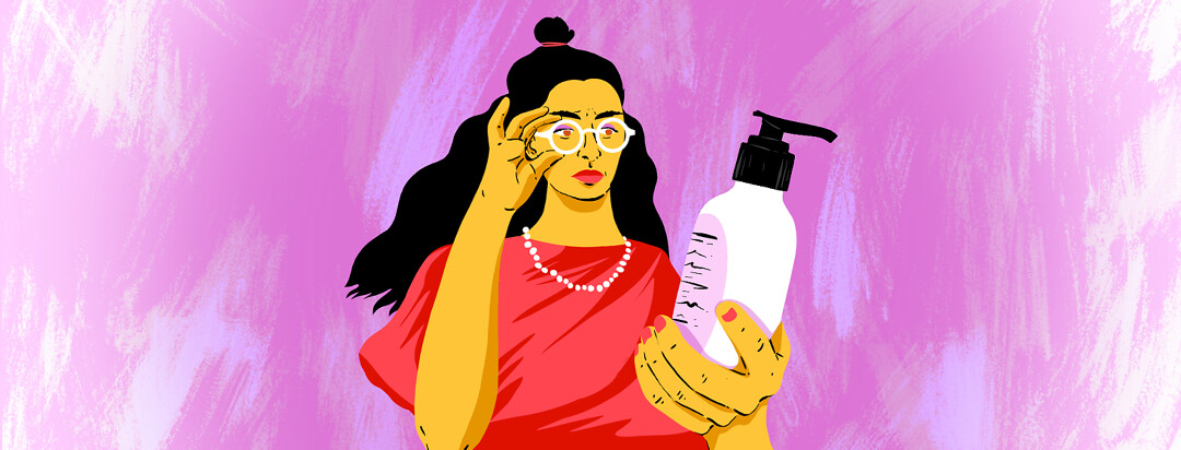 A woman holds a lotion bottle and inspects the ingredient label.