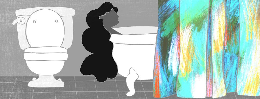 A woman lays in a bathtub.