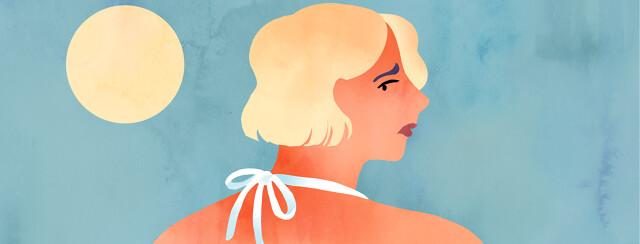 A woman worriedly glances back at her sunburned shoulders.